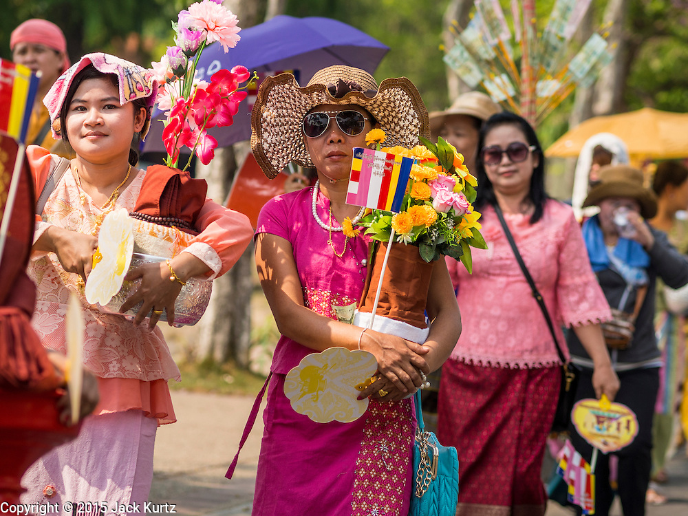 """04 APRIL 2015 - CHIANG MAI, CHIANG MAI, THAILAND: Tai (Shan) Burmese walk in a procession during the Poi Sang Long Festival in Chiang Mai. The Poi Sang Long Festival (also called Poy Sang Long) is an ordination ceremony for Tai (also and commonly called Shan, though they prefer Tai) boys in the Shan State of Myanmar (Burma) and in Shan communities in western Thailand. Most Tai boys go into the monastery as novice monks at some point between the ages of seven and fourteen. This year seven boys were ordained at the Poi Sang Long ceremony at Wat Pa Pao in Chiang Mai. Poy Song Long is Tai (Shan) for """"Festival of the Jewel (or Crystal) Sons.      PHOTO BY JACK KURTZ"""