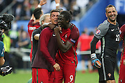 Portugal Forward Cristiano Ronaldo has tears and cry with teammate Portugal Forward Eder during the Euro 2016 final between Portugal and France at Stade de France, Saint-Denis, Paris, France on 10 July 2016. Photo by Phil Duncan.