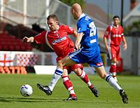 Photo: Ed Godden.<br />Swindon Town v Stockport County. Coca Cola League 2. 26/08/2006. Paul Evans (L) and Stockport's Jason Taylor (R).