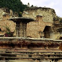 Central America, Guatemala, Antigua. earthquake damaged courtyard and fountain in Antigua.