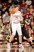 Nov 16, 2011; Fayetteville, AR, USA;  Arkansas Razorbacks forward Hunter Mickelson (21) makes a pass during a game against the Oakland Grizzlies at Bud Walton Arena. Arkansas defeated Oakland 91-68. Mandatory Credit: Beth Hall-US PRESSWIRE