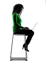 one mixed race young woman using laptop Computers silhouette isolated on white background