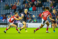 Darcy Graham (#14) of Edinburgh Rugby tries to evade the tackle of Leo Berdeu (#15) of SU Agen Rugby during the European Rugby Challenge Cup match between Edinburgh Rugby and SU Agen at BT Murrayfield, Edinburgh, Scotland on 18 January 2020.