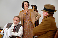 """AWAKE AND SING! -- Bobby Miller (left) playing the role of """"Jacob,"""" Elizabeth Ann Townsend, as """"Bessie,"""" and Aaron Orion Baker, in the role of """"Ralph,"""" participate in a photo call for The New Jewish Theatre's production of playwright Clifford Odets' Depression-era tale """"Awake and Sing!"""" at the rehearsal hall of the Opera Theatre of St. Louis on the campus of Webster University in Webster Groves, Mo. Wednesday, April 13, 2011. The play will be presented April 20-May 8 at the Wool Studio Theatre on the Jewish Community Center campus in Maryland Heights, Mo. Image © copyright 2011 Sid Hastings."""