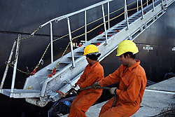 """Indian seafarers help dock the MSC Ingrid, which was at port in Limassol, Cyprus on Feb. 22, 2008. Cyprus is the crossroads of international ship management and  where all the agencies are recruiting and hiring the cheapest workers worldwide. Cyprus is also one of the """"Flag-of-Convenience"""" States like Panama and Liberia."""