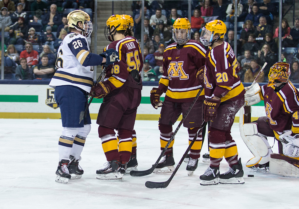 January 11, 2019:  Notre Dame forward Cam Morrison (26) and Minnesota forward Sampo Ranta (58) push and shove after the whistle during NCAA Hockey game action between the Minnesota Golden Gophers and the Notre Dame Fighting Irish at Compton Family Ice Arena in South Bend, Indiana.  Minnesota defeated Notre Dame 5-1.  John Mersits/CSM
