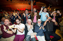 © Licensed to London News Pictures. 05/09/2015. Margate, UK.  Supporters applaud as Corbyn arrives on stage. Labour leadership candidate JEREMY CORBYN taking part in a rally in Margate in Kent, UK today (SAT).  Corbyn is currently the favourite to be announced as the new Labour party leader on September 12th. Photo credit: Ben Cawthra/LNP