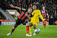 Dan Gosling and Raheem Sterling during the Capital One Cup match between Bournemouth and Liverpool at the Goldsands Stadium, Bournemouth, England on 17 December 2014.