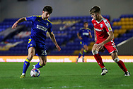 AFC Wimbledon attacker Ryan Longman (29) dribbling and taking on Gillingham FC defender Jack Tucker (5) during the EFL Sky Bet League 1 match between AFC Wimbledon and Gillingham at Plough Lane, London, United Kingdom on 23 February 2021.