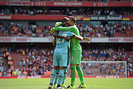 Angelo Ogbonna Obinze of West Ham United, Dimitri Payet of West Ham United and Goalkeeper Adrian of West Ham United celebrate after the final whistle. Barclays Premier League, Arsenal v West Ham Utd at the Emirates Stadium in London on Sunday 9th August 2015.<br /> pic by John Patrick Fletcher, Andrew Orchard sports photography.