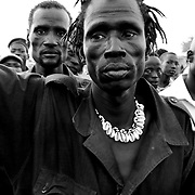 In Yuai, Jonglei, Dak Kueth, the self proclaimed prophet of the Lou Nuer tribe, stands in front of the Lou Nuer youth who just came back from cattle raiding. Kueth is one convincing about 4000 Lou Nuer to go attack the Murle tribe in Jonglei. Even though he is not part of the army, he wears the uniform and carries guns around.