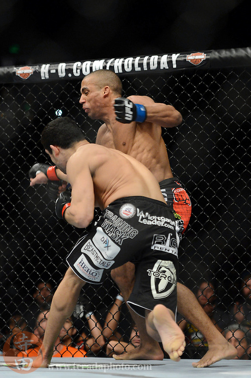 December 14, 2013; Sacramento, CA, USA; Danny Castillo (red gloves) fights Edson Barboza (blue gloves) during the lightweight bout of the UFC on FOX 9 at Sleep Train Arena.