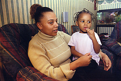Young girl sitting and talking to mother,