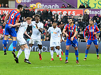 Football - 2017 / 2018 Premier League - Swansea City vs. Crystal Palace<br /> <br /> Scott Dann of Crystal Palace heads at goal, at the Liberty Stadium.<br /> <br /> COLORSPORT/WINSTON BYNORTH
