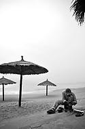 Shoe cleaner along a beach of Nha Trang, VIetnam, Southeast Asia