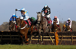 Air Horse One ridden by Noel Fehily (right) trails Divine Spear ridden by Ned Curtis over the last flight brfore going on to win The Les Ambassadeurs Casino Handicap Hurdle Race run during the Betfair Chase Raceday at Ascot Racecourse.