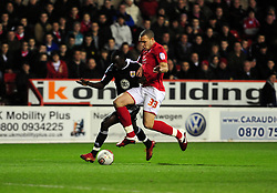 Bristol City's Albert Adomah Battles for the ball with Nottingham Forest's Joel Lynch - Photo mandatory by-line: Matt Bunn/JMP - 25/01/2011 - SPORT - FOOTBALL - npower championship-Nottingham Forest v Bristol city-City Ground-Nottingham