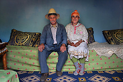 Omar ben Brahim, 62, and wife Fatima bent Ali, – she guessed her age between 59 and 61 – are seen at their home in the village of Aid ben Brahim outside Marrakech, Morocco on May 11, 2009. Omar ben Brahim spent his life working as a mason and built the home that he and his family live in.