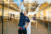 16 MARCH 2012 - SCOTTSDALE, AZ:  TALEK BEICKEL cleans the window of the Apple Store in Scottsdale before it opened to sell the New iPad Friday. Several hundred people were in line at the Apple Store in the Scottsdale Quarter in Scottsdale, AZ, Friday to buy the New iPad.    PHOTO BY JACK KURTZ