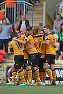 Lee Minshull of Newport (second left) celebrates after scoring his side's third goal. Skybet football league two match, Newport county v Northampton Town at Rodney Parade in Newport, South Wales on Saturday13th Sept 2014<br /> pic by Mark Hawkins, Andrew Orchard sports photography.
