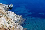 Looking down on small open boats moored on coast of deepblue sea, island of Ibiza, Balearic Islands, Spain, 1950s