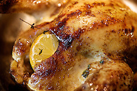 Roast chicken with lemon, garlic and thyme.