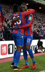 """Crystal Palace's Bakary Sako celebrates scoring his side's first goal of the game with team mate Christian Benteke during the Premier League match at Selhurst Park, London. PRESS ASSOCIATION Photo. Picture date: Saturday January 13, 2018. See PA story SOCCER Palace. Photo credit should read: Daniel Hambury/PA Wire. RESTRICTIONS: EDITORIAL USE ONLY No use with unauthorised audio, video, data, fixture lists, club/league logos or """"live"""" services. Online in-match use limited to 75 images, no video emulation. No use in betting, games or single club/league/player publications"""