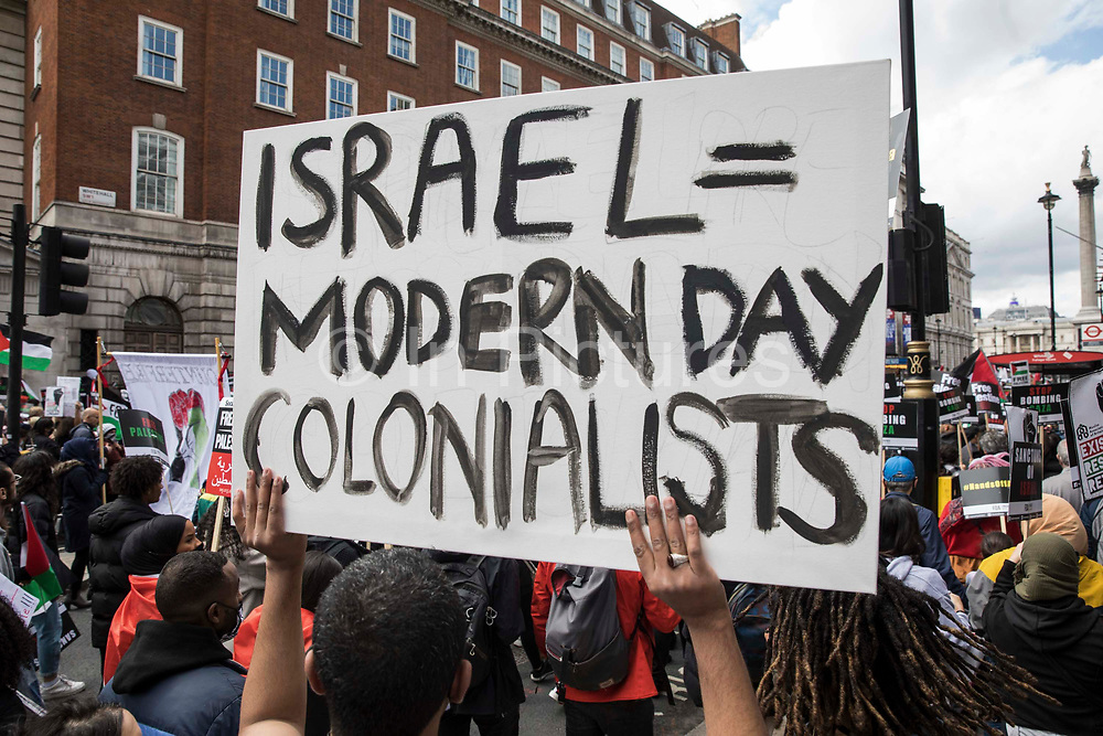 A man holds up a sign as tens of thousands of people take part in the National Demonstration for Palestine from Victoria Embankment to Hyde Park on 22nd May 2021 in London, United Kingdom. The demonstration was organised by pro-Palestinian solidarity groups in protest against Israels recent attacks on Gaza, its incursions at the Al-Aqsa mosque and its attempts to forcibly displace Palestinian families from the Sheikh Jarrah neighbourhood of East Jerusalem.