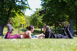 © Licensed to London News Pictures. 20/05/2020. London, UK. Women relax in Markfield Park, Tottenham, north London on a warm and sunny day in London. The government has relaxed the rules on the COVID-19 lockdown, allowing people to spend more time outdoors whilst following social distancing guidelines. According to the Met Office, 27 degrees celsius is forecast for today.  <br /> <br /> ***Permission Granted***<br /> <br /> Photo credit: Dinendra Haria/LNP