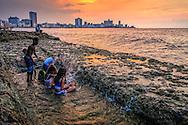 Children playing at sunset