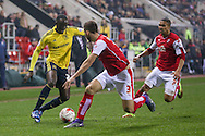 Middlesbrough midfielder Albert Adomah (27) takes on Rotherham United defender Joe Mattock (3)  during the Sky Bet Championship match between Rotherham United and Middlesbrough at the New York Stadium, Rotherham, England on 8 March 2016. Photo by Simon Davies.