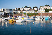 Boats moored in the harbour at Paignton, Devon, England, UK