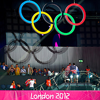 Spectators pose for a photograph under the Olympic rings at the USA and Argentina semi-final game at the North Greenwich Arena during the 2012 London Summer Olympics.