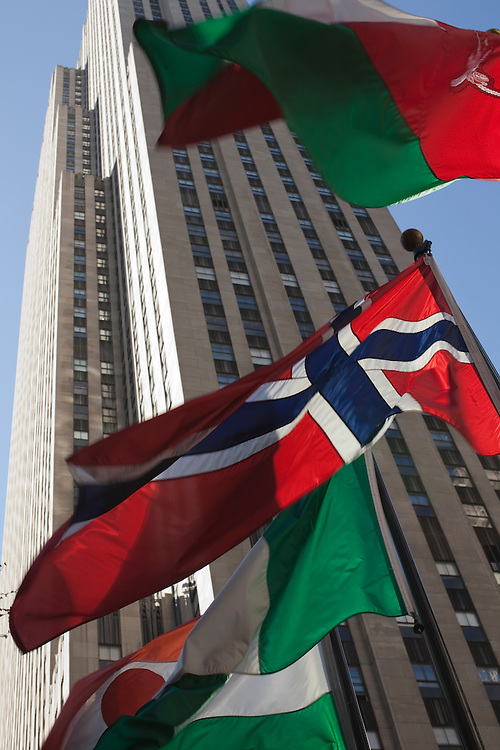 International flags waving in front of Rockefeller Center in Manhattan.