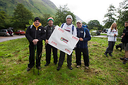 John with Iain King and the Sun flag..The John Hartson Foudation walk up Ben Nevis..Pic ©2010 Michael Schofield. All Rights Reserved.