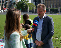 Richard Ratcliffe At the  photocall the  took place in Parliament Square to mark Nazanin Zaghari-Ratcliffe's 2000th day of being detained in Iran, A giant snakes and ladders board was used to show the ups and downs of Nazanin's case