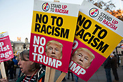 Placards for the No to Trump, No to NATO, Hands off our NHS Demonstration on 3rd December 2019 in London, United Kingdom. Donald Trump is visiting London or the NATO Heads of State summit on the 70th anniversary of the organisation, which the Queen will be hosting a reception for NATO leaders at Buckingham Palace. Meanwhile, there is fear that Boris Johnson and Donald Trump will be in discussion about opening up the NHS to US corporations. Organisers were Together Against Trump which is a collaboration between the Stop Trump Coalition and Stand Up To Trump.