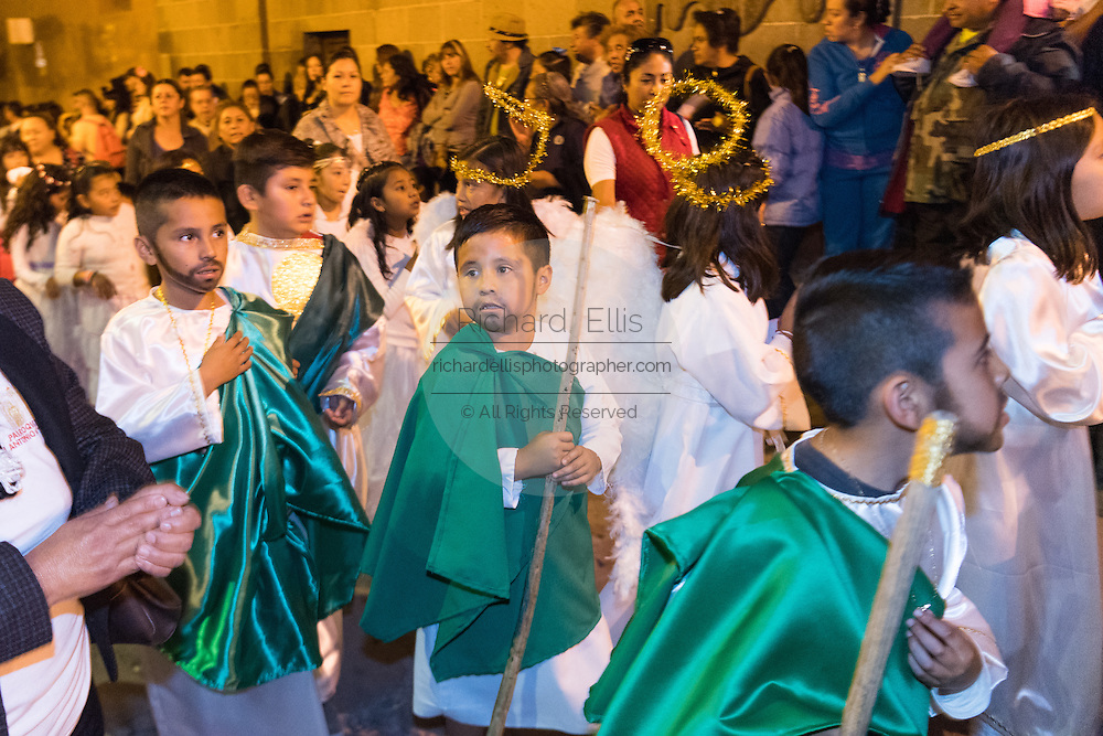 """Dressed as angels young Mexican children during the """"Procession of Angels"""" through the public square family during the Day of the Dead festival November 1, 2016 in San Miguel de Allende, Guanajuato, Mexico. The week-long celebration is a time when Mexicans welcome the dead back to earth for a visit and celebrate life."""
