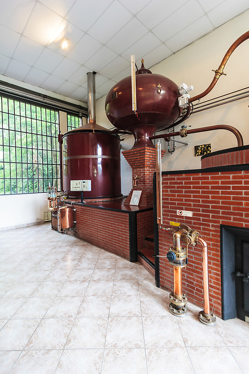 An alembic pot still at  Château du Breuil in Normandy, France. Calvados Pays d'Auge requires double distillation, and it is carried out in a traditional alembic pot still, called either l'alambic à repasse or Charentes.