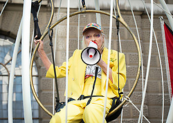 Dame Vivienne Westwood is suspended in a ten foot high bird cage outside the Old Bailey to protest against the US extradition of Julian Assange at The Old Bailey, 32 Old Bailey, London, Great Britain <br /> 21st July 2020 <br /> <br /> <br /> Photograph by Elliott Franks