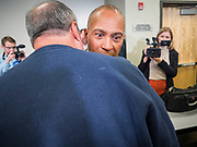 18 NOVEMBER 2019 - DES MOINES, IOWA: Former Governor DEVAL PATRICK (D-MA) talks to a Polk County Democrat after the Democrats' November monthly meeting in Des Moines Monday night. Gov. Patrick made his first campaign trip to Iowa Monday after announcing his candidacy to be the Democratic nominee for the US Presidency. His stops included a meeting of the Polk County Democrats in Des Moines. Iowa hosts the first presidential selection event of the 2020 presidential election cycle. The Iowa Caucuses are Feb. 3, 2020.           PHOTO BY JACK KURTZ