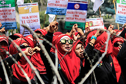 May 1, 2019 - Central Jakarta, Jakarta, Indonesia - Womens labours and workers shout slogans as they march along a road near the Presidential Palace during a May Day rally in Jakarta, Indonesia. Thousands of workers are urging the government to raise minimum wages and improve working conditions. (Credit Image: © Risa Krisadhi/Pacific Press via ZUMA Wire)