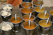 Buckets of food prepared for worshippers at Sri Swami Santdas Udaasin Ashram, in Ujjain, India, during the Kumbh Mela festival.