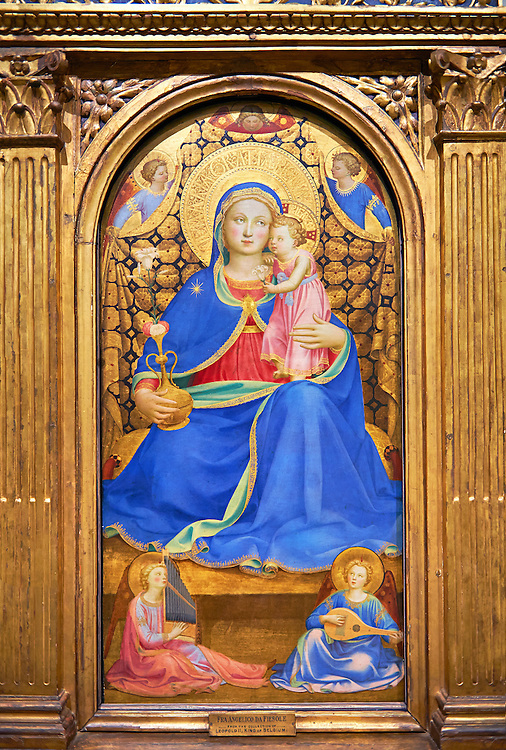 Gothic panel of the (Virgin Mary) Madonna of Humility. Polychrome and gold leaf on wood, circa 1433-1435. The Virgin is seated on a cushion on the floor holding the baby Jesus. She hand a jug with roses a symbol of motherhood and purity. Behind her a gold curtain is held by three angels, while two others are sitting on the floor are playing the organ and lute. The skill of the use of light and shade and the fine brushwork points to an artist of great skill using the Quattrocento style. The piece has been identified as that described by the writer on art Giorgia Vasari in 1568 which was owned Gondi family in Florence.. Inv MNAC 212817. National Museum of Catalan Art (MNAC), Barcelona, Spain .<br /> <br /> If you prefer you can also buy from our ALAMY PHOTO LIBRARY  Collection visit : https://www.alamy.com/portfolio/paul-williams-funkystock/romanesque-art-antiquities.html<br /> Type -     MNAC     - into the LOWER SEARCH WITHIN GALLERY box. Refine search by adding background colour, place, subject etc<br /> <br /> Visit our ROMANESQUE ART PHOTO COLLECTION for more   photos  to download or buy as prints https://funkystock.photoshelter.com/gallery-collection/Medieval-Romanesque-Art-Antiquities-Historic-Sites-Pictures-Images-of/C0000uYGQT94tY_Y
