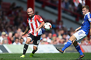 Alan McCormack of Brentford in action (l). Skybet football league Championship match, Brentford v Ipswich Town at Griffin Park in London on Saturday 8th August 2015.<br /> pic by John Patrick Fletcher, Andrew Orchard sports photography.