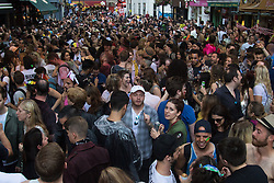 Portland Place, London, June 25th 2016. Thousands of LGBT people and their supporters gather for Pride in London, a colourful celebration of the hard-won rights of lesbian, gay, bisexual and transgender  people. PICTURED: Thousands dance in the rain in Soho.