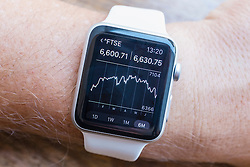 Summary chart of FTSE stock market performance  showing on an Apple Watch