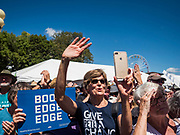 13 AUGUST 2019 - DES MOINES, IOWA: People cheer for Pete Buttigieg after his program at the Des Moines Register Political Soap Box. Buttigieg, the Mayor of South Bend, Indiana, is running to be the Democratic nominee for the US presidency. He spoke at the Des Moines Register Political Soap Box at the Iowa State Fair and then toured the fairgrounds. Iowa has the first event of the presidential selection cycle. The Iowa Caucuses are February 3, 2020.                PHOTO BY JACK KURTZ
