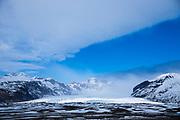 Blue sky over glacial tongue of Svinafellsjokull glacier, an outlet glacier of Vatnajokull, the largest ice cap in Europe, Iceland