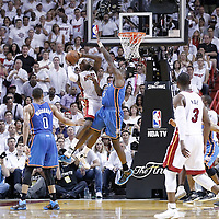 21 June 2012: Miami Heat small forward LeBron James (6) goes to the basket over Oklahoma City Thunder center Kendrick Perkins (5) during the second quarter of Game 5 of the 2012 NBA Finals, at the AmericanAirlinesArena, Miami, Florida, USA.